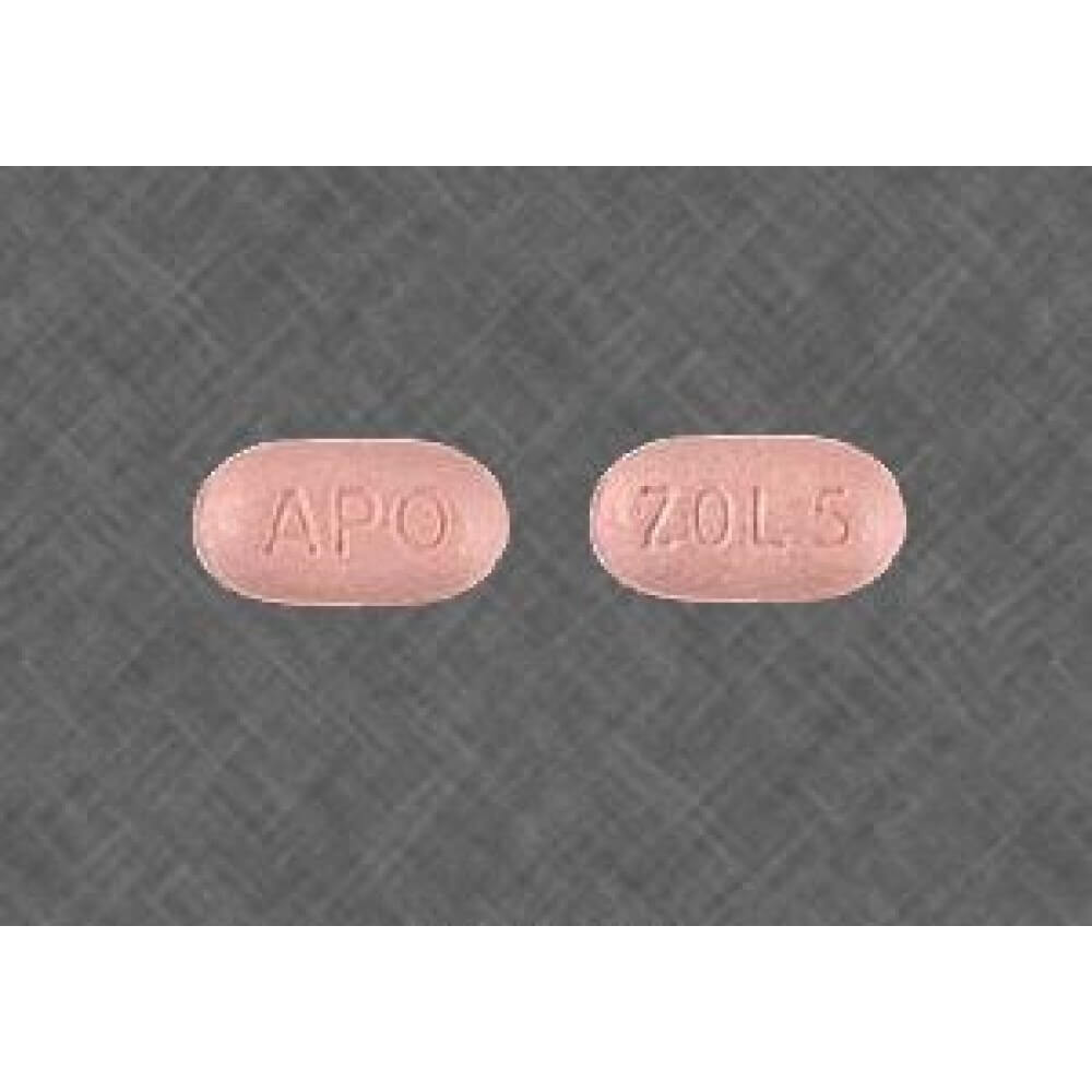 Grey background image of ambien 5mg tablets front and backside view